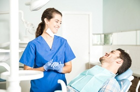 Dental professional and patient discussing cost of cosmetic bonding