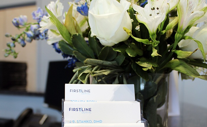 Flowers and business cards on reception desk